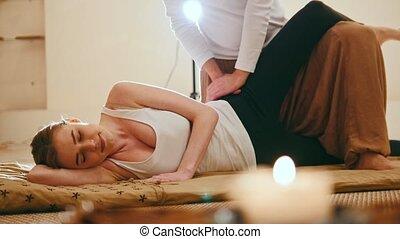 Thai therapy - massage - caucasian female gets pleasure in spa salon, slider shot