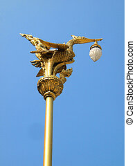Thai traditional beautiful golden swan on street lamp post in Bangkok, Thailand.