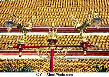 Thai traditional beautiful golden swan on street lamp post in Ba