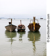 Thai traditional Long-tailed boat in the bay