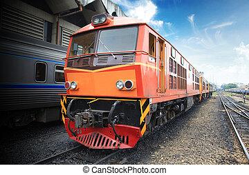Thai train arriving at station