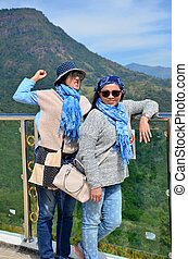 Thai woman and old women playing and portrait with view of Khao Kho mountain