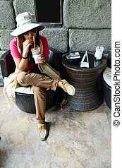 Thai woman drink coffee