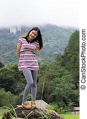 Thai Woman Enjoy on The rock in Field Doi inthanon, Maeglangluan