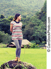 Thai Woman Enjoy On The Rock with Green Field in Doi inthanon,