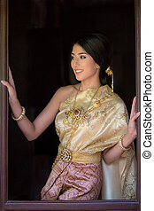 Thai Woman In Traditional Costume Of Thailand in old sty...