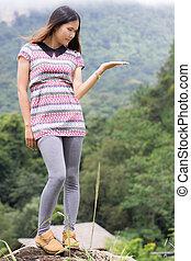 Thai Woman on The rock in Field Doi inthanon, Maeglangluang Kare