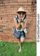 Thai woman portrait at Brick wall