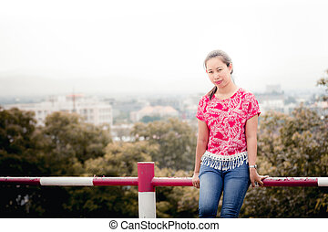 Thai woman portrait with Chiangmai city view