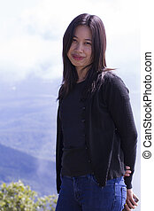 thai woman portrait with mountain
