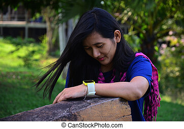 Thai woman portrait with wooden label of Kaeng Krachan largest national park