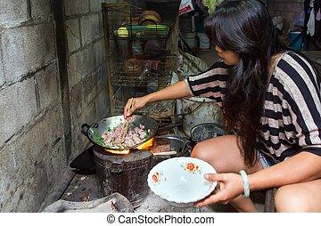 Thai woman preparing traditional meal