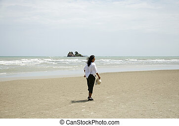 Thai woman walk and relax on sand beach at Laem Charoen beach and Mae Pim beach