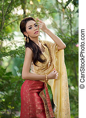 Thai woman wearing typical Thai dress, identity culture of...