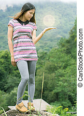 Thai Woman with ligth on The rock in Field Doi inthanon, Maeglangluang Karen villages