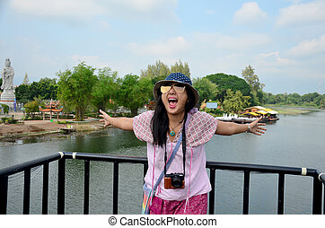 Thai women travel and portrait at the Bridge over the River Kwai