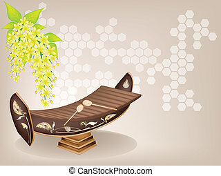 Thai Xylophone and Cassia Fistula Flower on Brown Background