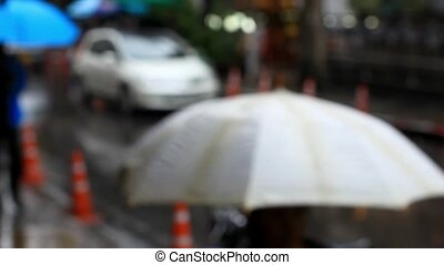 Thailand, Bangkok, 1 August 2014. Cars go on the road and people walking with umbrellas in  rain on street In city. blurred background. HD. 1920x1080