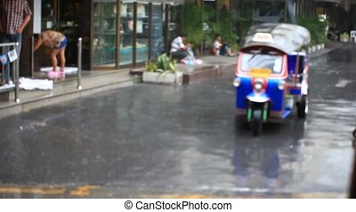 Thailand, Bangkok, 1 August 2014. Road in the city centre during torrential rain. Blurred background. HD. 1920x1080