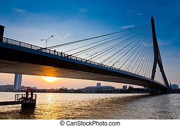 Thailand, Bangkok, view of the Rama VIII Bridge and the Chao Praya river at sunset