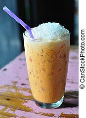 Thailand beverage, cold-milk-tea on painted desk.