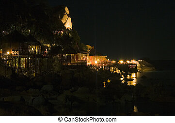 Thailand bungalows illuminated at night