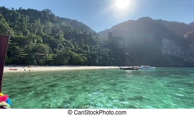 Thailand coast as seen from a moving boat, Surin Islands on a beautiful sunny day.