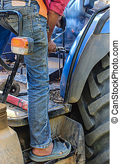 Thailand Country welder repairing the tractor detail