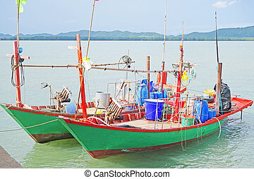 thailand country wooden fishing boat on a sea