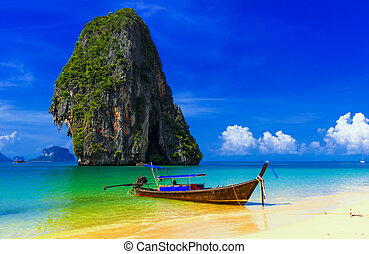 Thailand exotic tropical beach. Blue sky, sand and traditional boat