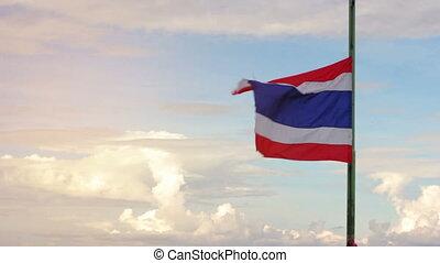 Thailand flag wave cloud background