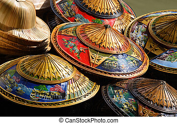 Hundreds of souvenir hats piled high for tourists visiting Thailand to buy.