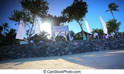 THAILAND, KOH SAMUI, JULY 2.2014: Wedding preparation on Thai beach against a background of blue sky. Video