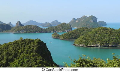 Thailand National Marine Park aerial view in Pacific Ocean. Majestic hilly islets with green grass on water surface. Thai natural wonders wildlife in Mu Koh Angthong. Footage panoramic shot in 4K, UHD