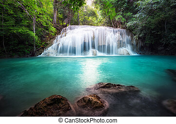 Thailand outdoor photography of waterfall in rain jungle forest.