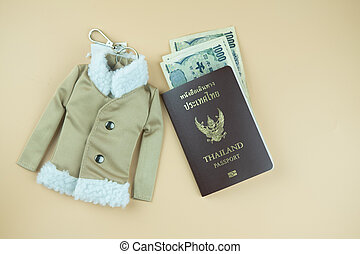 Thailand passport and Japan money with winter coat key ring for travel in Japan.