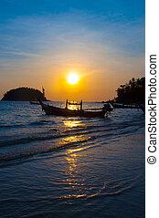 Thailand sunset, boat on coast