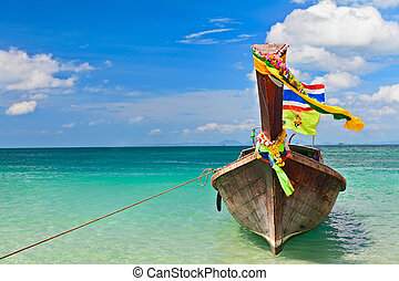 Thailand traditional longtail boat on tropical beach