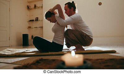 Thailand traditional therapy for head and spine - blonde...
