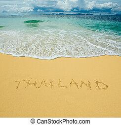 thailand written in a sandy tropical beach