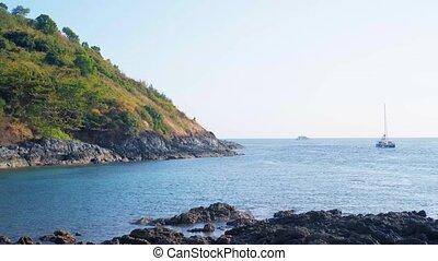 Thailand. Ya Nui Beach cap. Rocks and sea. Yacht. 4K