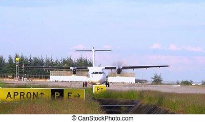 Thailland. Phuket International Airport. Airfield. Propeller, twin-engine aircraft start engines. Slow Motion.