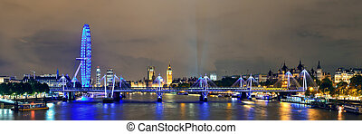 Thames River night with London urban architecture.