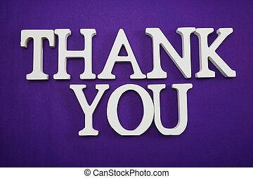 Thank You alphabet letters on purple background
