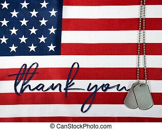 thank you and dog tags on flag