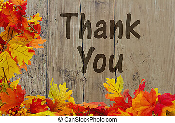 Thank You, Autumn Leaves with grunge wood with text Thank...