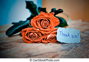 Thank you card and red roses