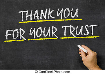 Thank you for your trust written on a blackboard