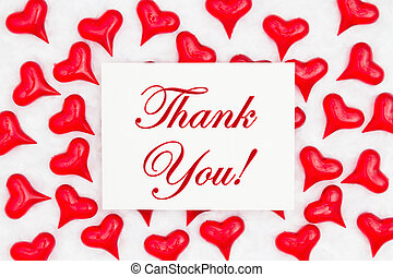 Thank you greeting card with red hearts on white fabric