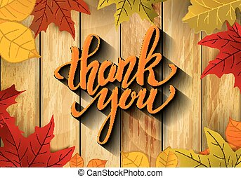 Thank You. Hand drawn lettering with yellow autumn leaves on woo